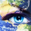 Planet Earth and blue human eye with violet and pink day makeup. Eye painting — Stock Photo #76857435