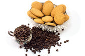 Coffee beans in a mug and cookies — Stock Photo