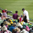 Cricketer with autograph seekers — Stock Photo #62244313
