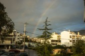 Rainbow over the suburb of Athens — Stock Photo