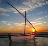 Fountain - sailboat at sunrise — Stock Photo