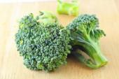 Green broccoli on wood board — Stockfoto