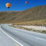 Balloons flying above road to Omarama — Stock Photo #63820675