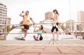Group of young attractive mixed race runners enjoying a morning of exercise — Stock Photo