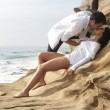 Young beautiful couple flirting and laughing together at the beach — Stock Photo #65671137
