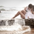 Young beautiful  in love couple having fun flirting at the beach — Stock Photo #65673825