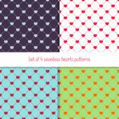 Set of 4 many-colored seamless patterns with rhombuses and hearts — Stock Vector