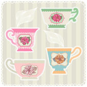 Tea cups with dahlias. — Stock Vector