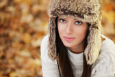 Beautiful young woman with brown fur hat — Stock Photo