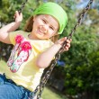 Pretty little girl on outdoor seesaw — Stock Photo #62548501