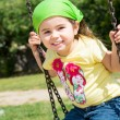 Pretty little girl on outdoor seesaw — Stock Photo #62548617