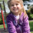 Pretty little girl on outdoor seesaw — Stock Photo #62549217