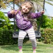 Pretty little girl on outdoor seesaw — Stock Photo #62549587