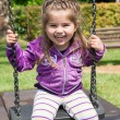 Pretty little girl on outdoor seesaw — Stock Photo #62549635