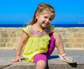 Beautiful cute happy little girl smiling in a sunny day — Stock Photo