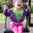 Pretty little girl on outdoor seesaw — Stock Photo #62550055