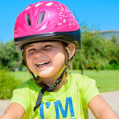 Girl with bicycle helmet — Photo