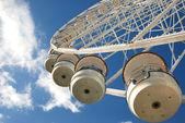 Carousel in blue sky — Stock Photo