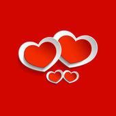 Červené a bílé srdce — Stock vektor