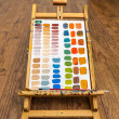 Easel with color mixing exercise on paper — Stock Photo #69974225