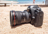 Sharm el Sheikh, Egypt - June 29, 2015: Canon 5D mark 2 interchangeable-lens professional dslr camera on the sand on the beach. Dust proof. — Stock Photo