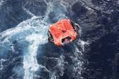 Life raft in rough seas — Stock Photo
