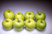 Fresh eight green apples painted with light — Stockfoto