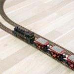 Model steam train on wooden floor, game for kids — Stock Photo #65350881