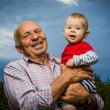 Grandfather Holding Grandson — Stock Photo #62895329