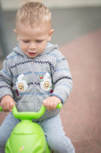 Baby Boy Riding a Plastic Scooter — Stock Photo