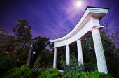 Trees behind the columns — Stock Photo