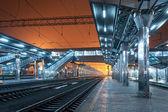 Railway station at night. Train platform in fog. Railroad — Stock Photo