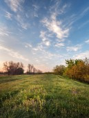 Beautiful sunset. Spring landscape with trail, trees, sky and cl — Stock Photo