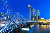 The Helix Bridge and Marina Bay Sands Hotel at night — Stock Photo