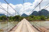 Wooden bridge over Nam Song river, Vang Vieng — Stock Photo