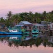 Fishing boats near houses of fishermen in rural area of Phu Quoc Island — Stock Photo #66000743