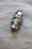 Woman on boat at Can Tho Floating Market — Stockfoto