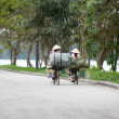 : Two vietnamese women riding the bicycle on the street of Hue, Vietnam — Stock Photo #79684680