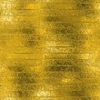Golden Foil luxury seamless and tileable background texture. Glittering holiday wrinkled gold background and shiny bright metal surface backdrop. — Stock Photo #63219047