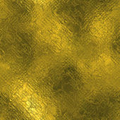 Golden Foil Seamless and Tileable Luxury background texture. Glittering holiday wrinkled gold background and shiny bright metal surface backdrop. — Стоковое фото