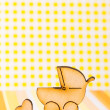 Wooden icon of baby carriage and little heart on yellow backgrou — Stock Photo #68321065