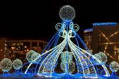 Christmas illuminations in the night city — Stock Photo