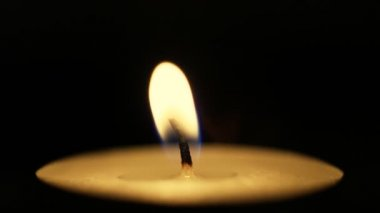 Closeup of candle on black. — Stock Video