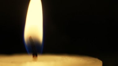 Closeup of candle flame on black. — Stock Video