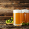 Постер, плакат: Mugs of beer with ears of wheat and hops