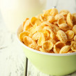 Bowl of cornflakes with jug of milk — Stock Photo #63087205