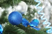 Christmas baubles on christmas tree — Stock Photo