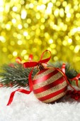 Branch of Christmas tree with ball — Stock Photo
