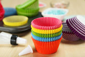 Empty colorful cupcake cases — Stock Photo