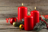 Branch of Christmas tree and candles — Stock Photo